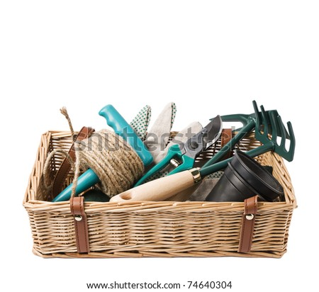 Gardening basket with tools isolated on white