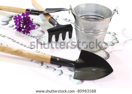 Gardening sketch with garden tools and flower