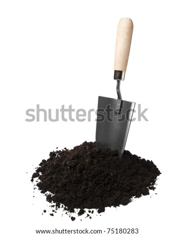 Gardening spade in soil isolated on white