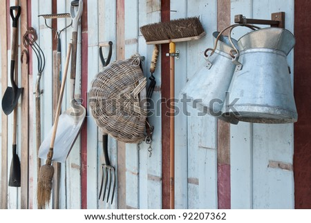 Gardening tools hanging on the wall