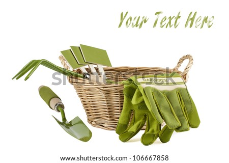 gardening tools kit including trowel, cultivator, plant markers and gloves in wooden basket isolated on white background with easy removable sample text - stock photo