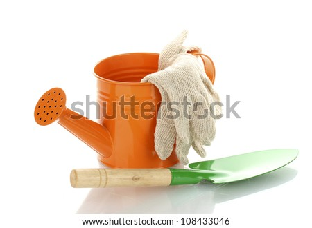 Gardening trowel, watering can and gloves isolated on white