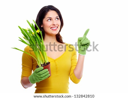 Gardening woman with plant. Isolated on white background. #132842810