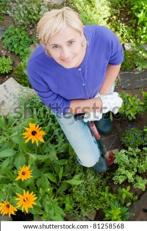 Gardening - woman working in the garden - stock photo