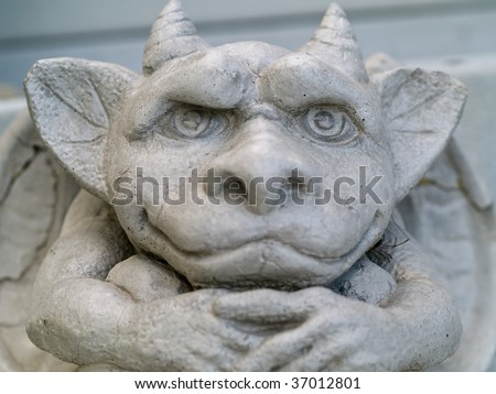 Gargoyle statue taken with emphasis on face and eyes