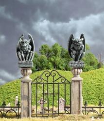 Gargoyle Statues on Iron Gated Cemetery Entrance