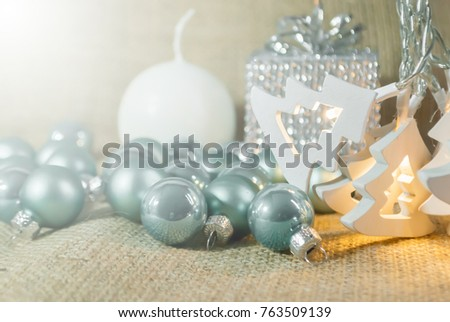 Garland light in pine tree form with blue christmas ball put on gunny bag nature with background blurry silver gift box and white candle.Christmas and new year  for decoration at home #763509139