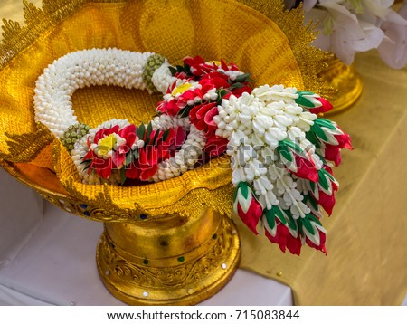 Garland or Lei of flowers on gold tray with pedestal #715083844