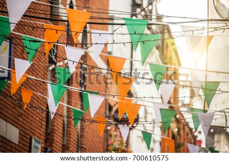 Garland with irish flag colors in a street of Dublin, Ireland - Saint Patrick day celebration concept