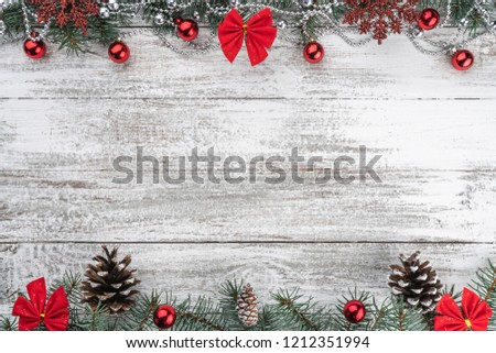 Garlands, baubles, snowflakes and other holiday items. Fir branches and cones. Xmas greeting card. Old wooden Christmas background. Top view. Space for your text. #1212351994