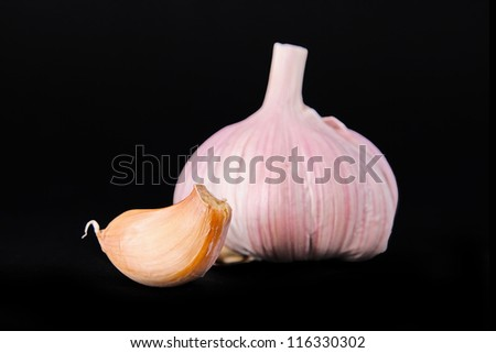 Garlic and cloves isolated on black background