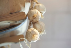 Garlic and onions hanging in the kitchen