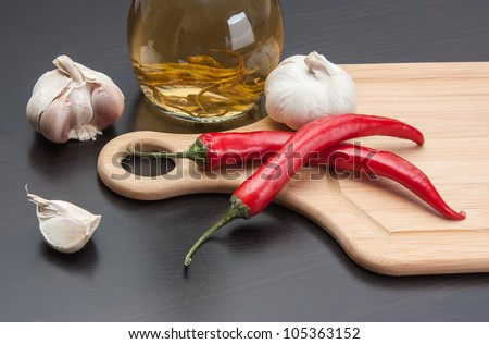 garlic and red chili peppers on the kitchen table