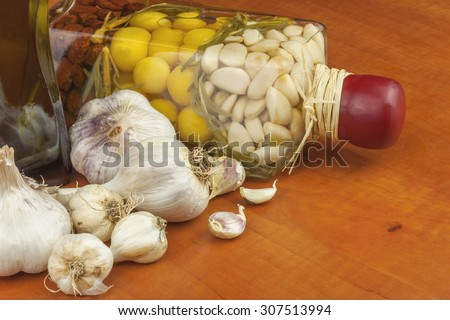 Garlic, aromatic ingredients for flavoring food. Home remedy for colds and flu. Garlic marinated in olive oil. Seasoning food. Preparing for the garden party and barbecue meat