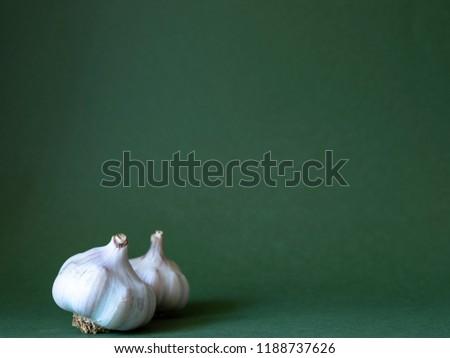 Garlic balb on green background