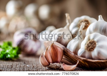 Garlic close up, Garlic bulb, Garlic cloves in wooden bowl,