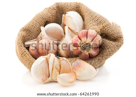 Garlic close up in canvas sack, isolated on white background - stock photo