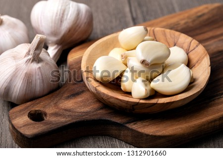 Garlic Cloves and Bulb in vintage wooden bowl Сток-фото ©