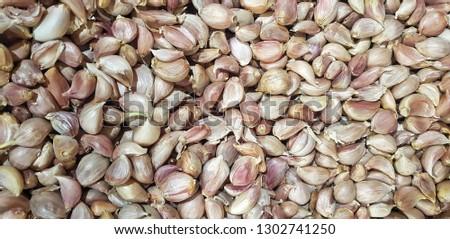 Garlic cloves closeup.Garlic cloves background.Garlic cloves top views.Garlic cloves in the market #1302741250
