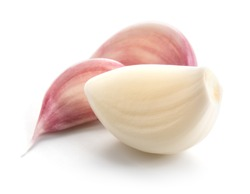 Garlic cloves isolated on white background.