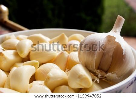 garlic. cloves of garlic. peeled garlic cloves #1159947052