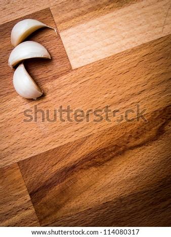 Garlic cloves on cutting board