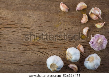 garlic cloves on wooden vintage ...