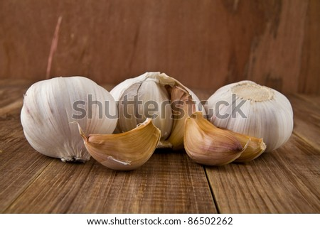 garlic on a wooden table - stock photo
