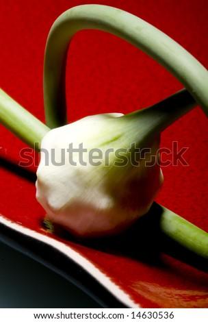 garlic on red plate