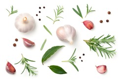 Garlic, rosemary, bay leaves, allspice and pepper isolated on white background. Flat lay. Top view