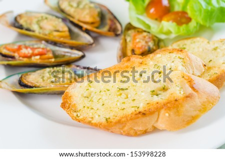 Garlice bread and mussel cheese - stock photo