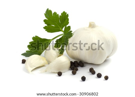 garlics with black pepper and green parsley leaves on white background