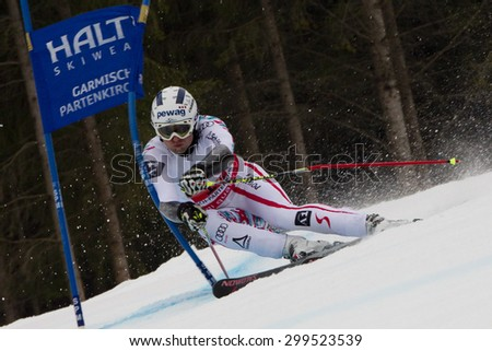 GARMISCH PARTENKIRCHEN, GERMANY. Feb 16 2011: Romed Baumann (AUT) competing in the team event a parallel slalom race  at the 2011 Alpine skiing World Championships