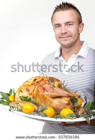 Garnished citrus glazed roasted turkey on platter is ready to be served