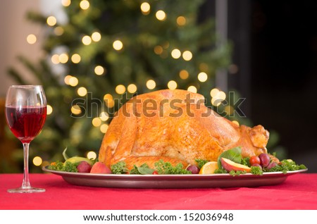 Garnished roasted turkey on holiday with red wine