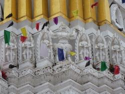 Garuda and soldiers are dancing around the beautiful prang of Wat Phra Si Ratana Mahathat in Phitsanulok