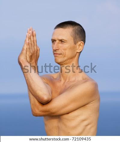 """stock photo : Garudasana - """"pose of eagle"""".Yoga exersicing outdoor"""