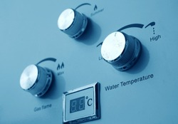 gas and water heater controls closeup