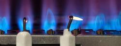 Gas burns in modern water heater. Closeup. Selective focus.