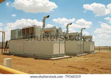 Gas compressor packages, heat sinks on top of containers.
