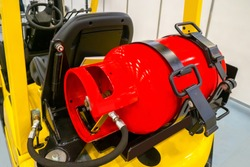 Gas cylinder on the forklift.  LPG gas for forklift trucks. Equipment for the warehouse.  Production and use LPG gas.