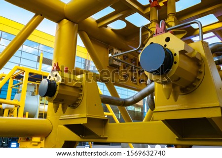 Gas distribution station. Gas equipment yellow. Production and supply of fuel. Gas industry. Fuel industry. Large industrial enterprise. Industrial concept. #1569632740