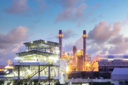 Gas fired power plant and factory building at night. Also called gas fired power station or natural gas power plant. That technology to burn natural gas and generate electricity or electrical energy.