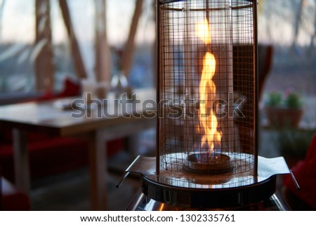 Gas flame heater typically used on outdoor patios and restaurants.