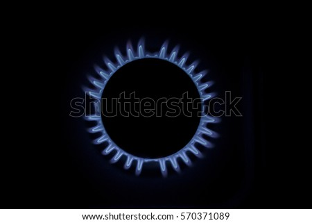 Gas flame with blue reflection stock photo