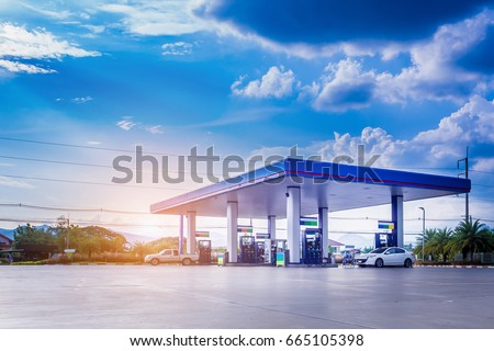 Gas fuel station with clouds and blue sky #665105398