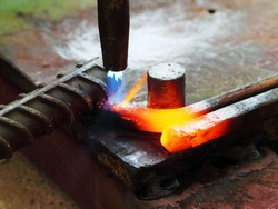 Gas heating cutting metal using torch and bending square bar