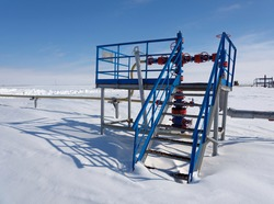 Gas industry, hydrocarbon production, gas well on the background of snow cover