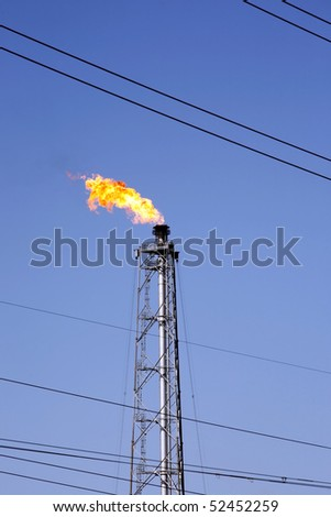 gas oil flare and power line wires