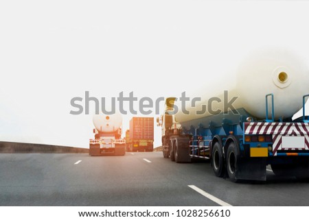Gas or oil Truck on highway road container, transportation concept.,import,export logistic industrial Transporting Land transport on the asphalt expressway #1028256610